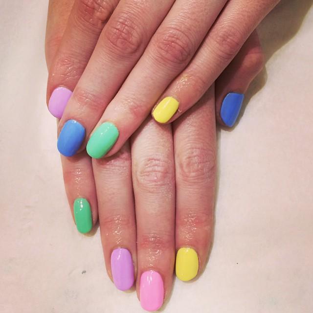 Multicoloured gel nail art manicure