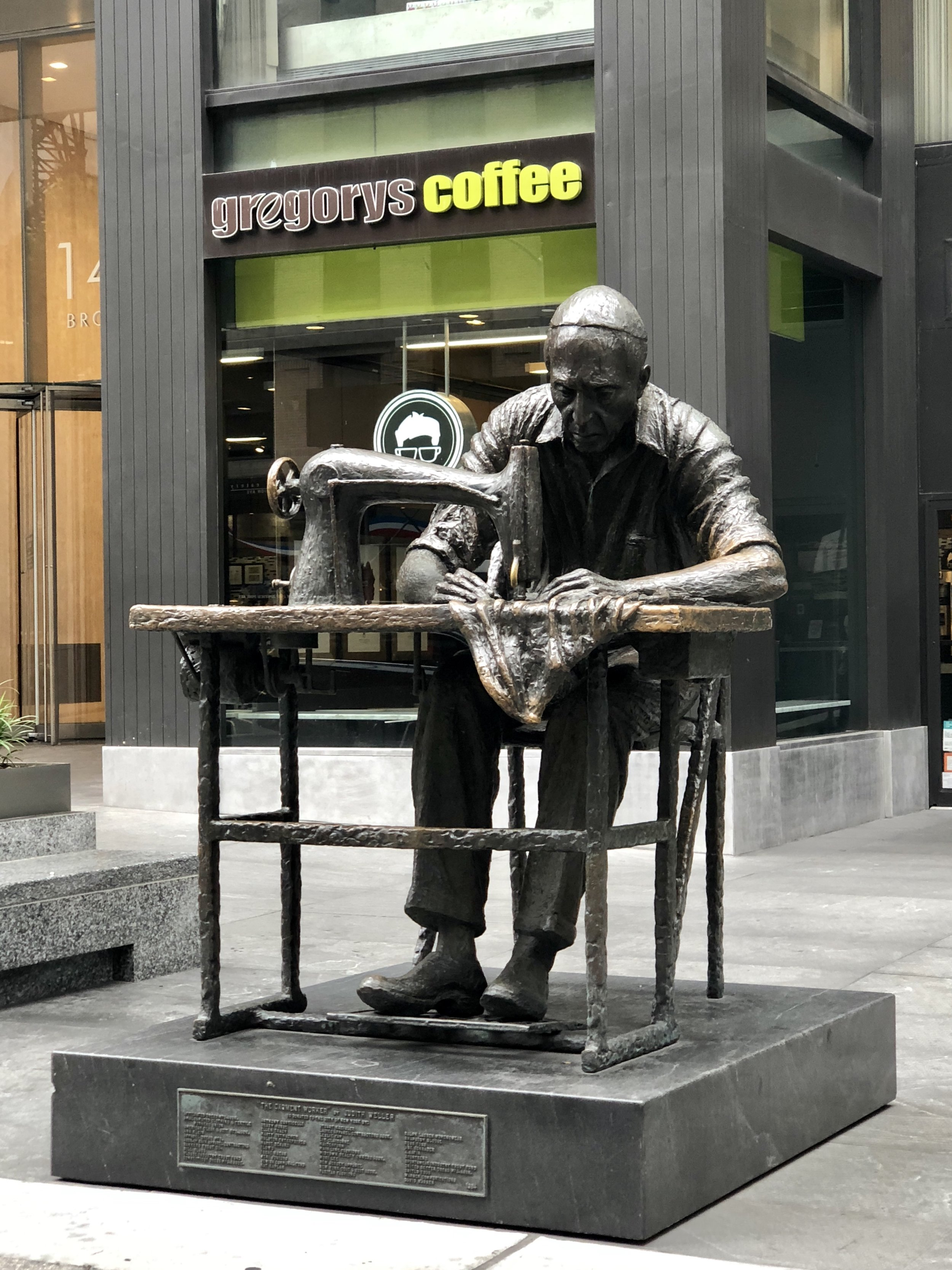 I guess, this statue represents the Fashion Ave or Garment District which is 7th Ave.