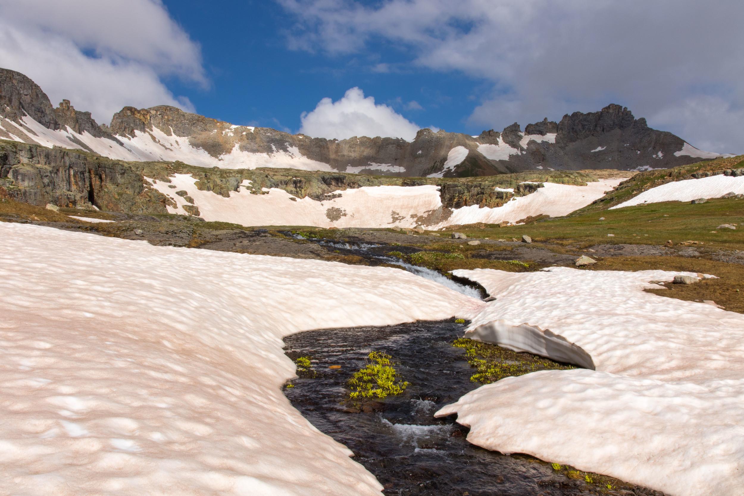 Stream running through snowfield at Porphyry Basin, Image #5326