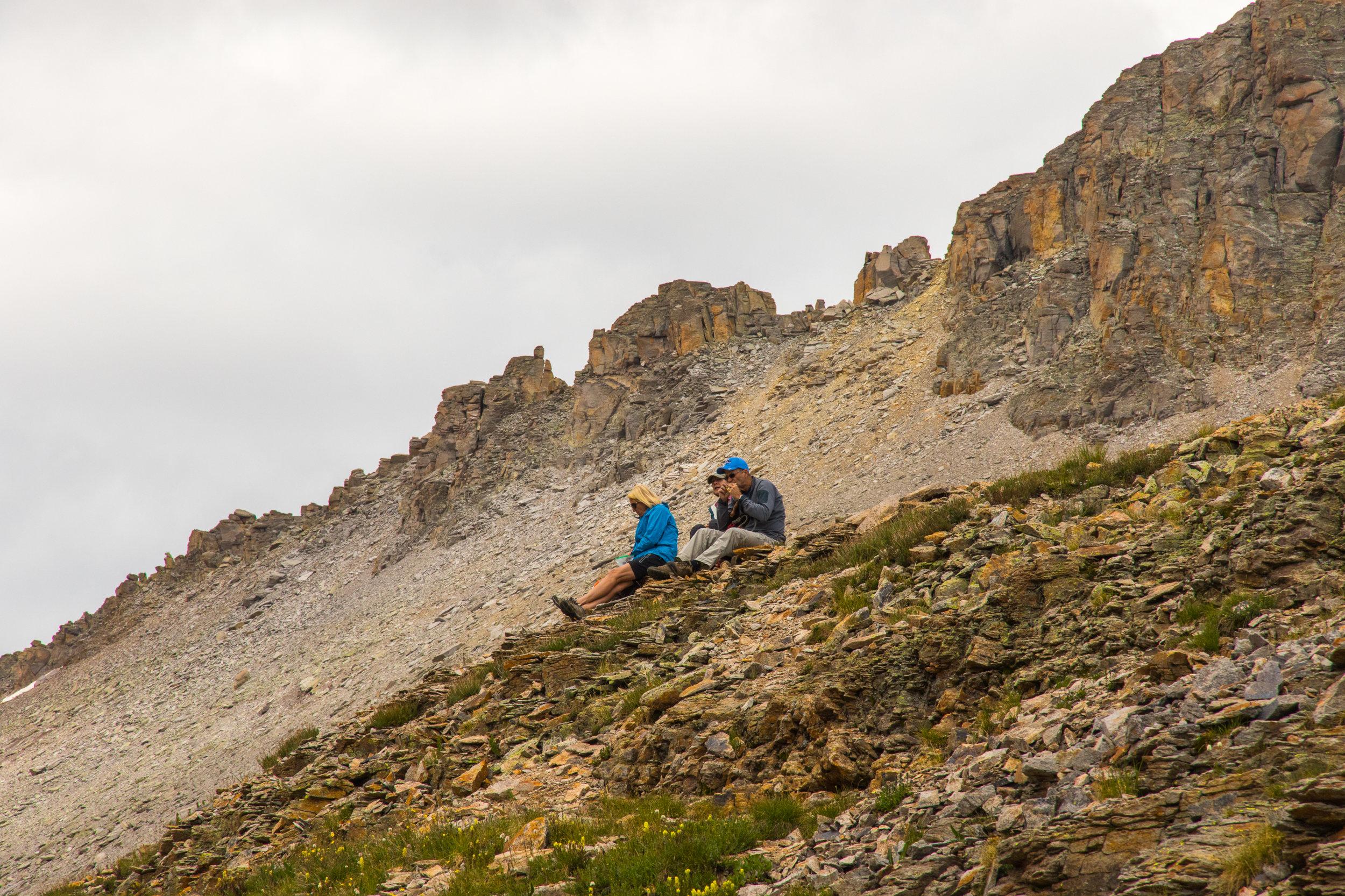 Tim, Angela & Mary enjoy the lunch spot overlooking Columbine Lake