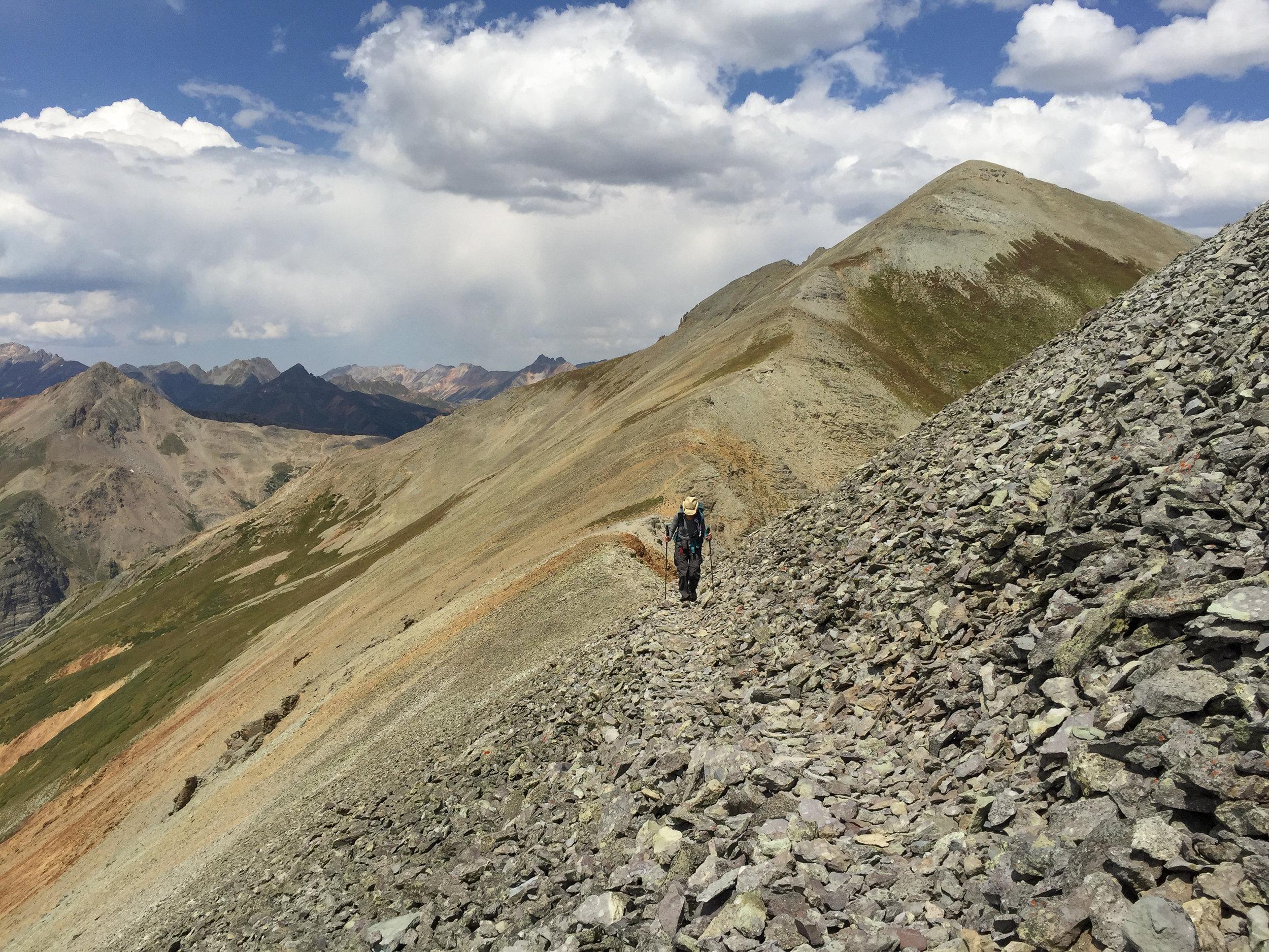 Penny on the narrow rocky trail