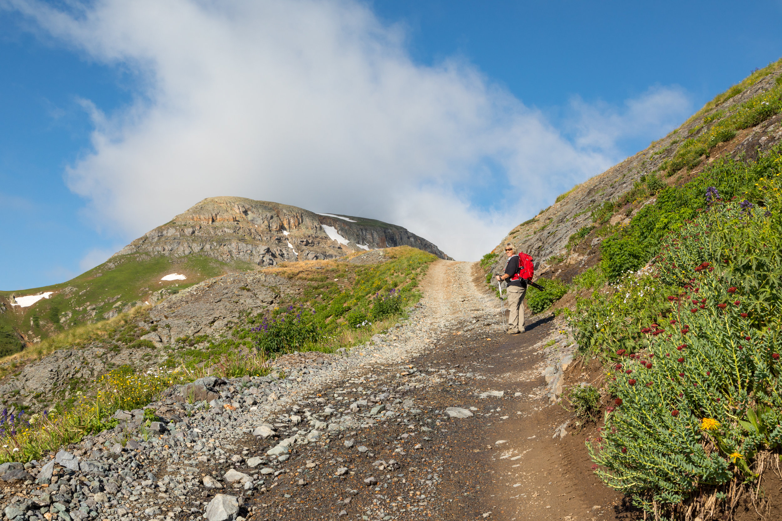Rita walking up to Porphyry Basin, Image # 9975