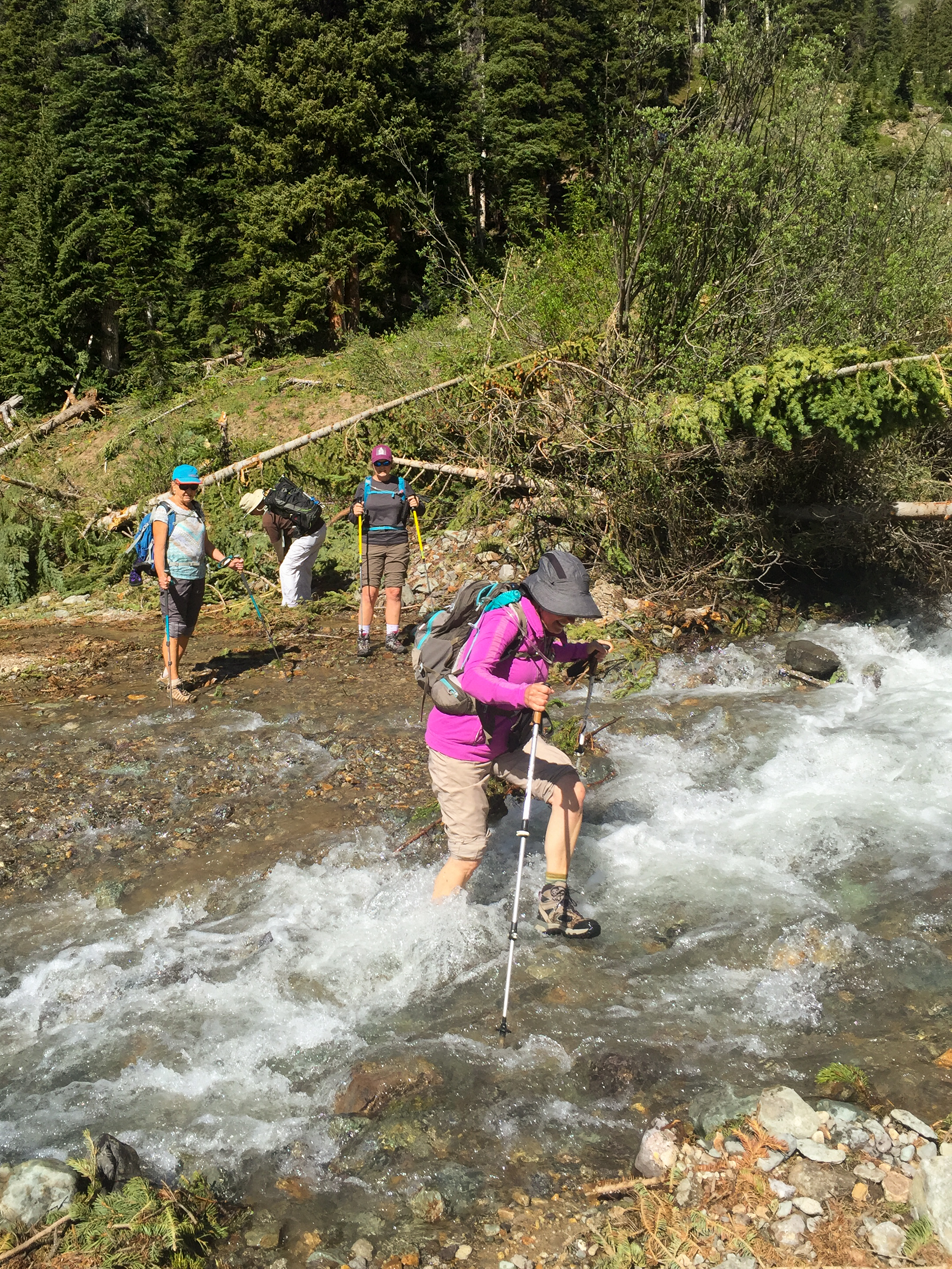 The second water crossing was a little deeper. Notice Gina pulled her pants up higher this time.