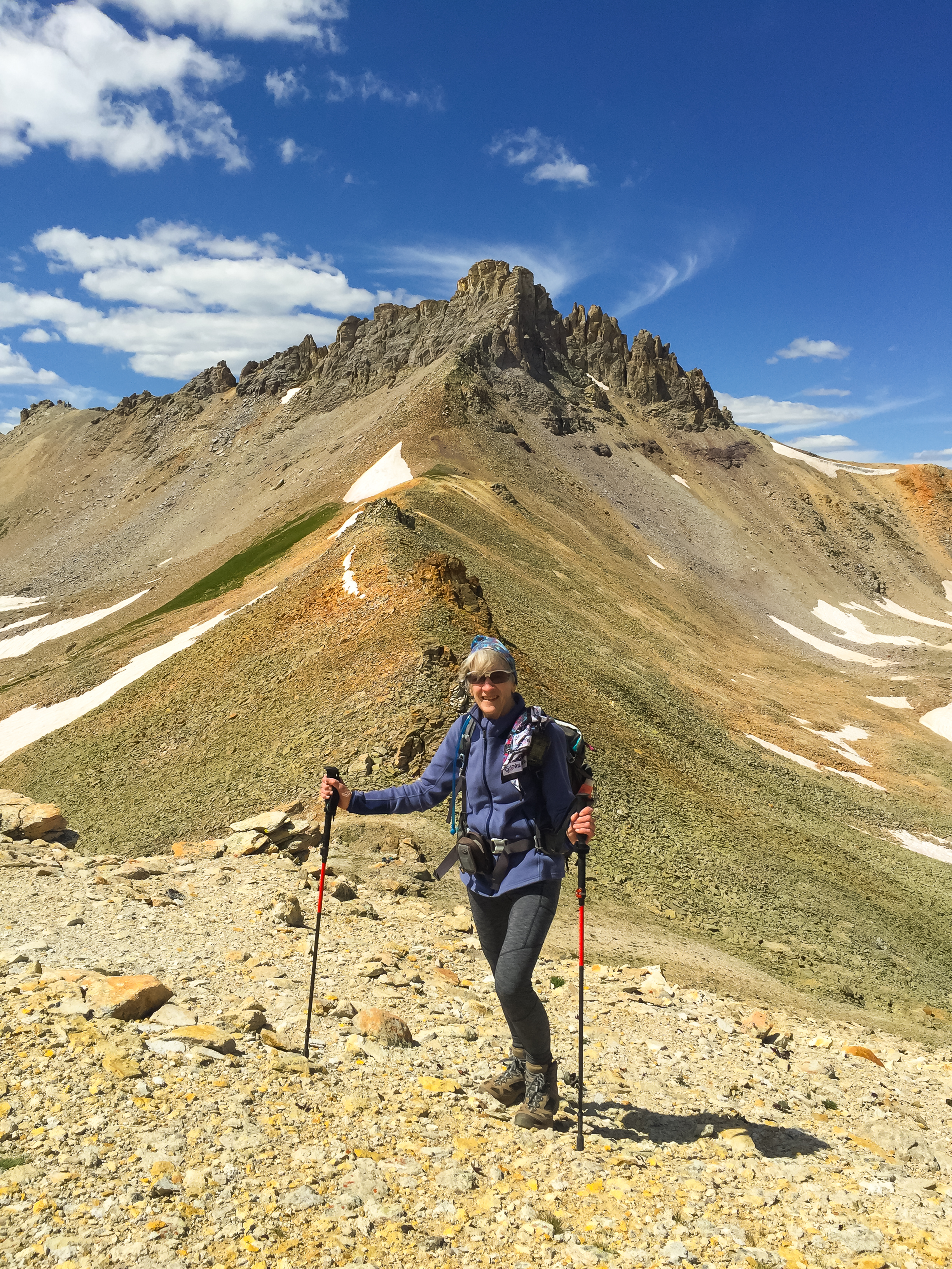 Penny at 13,050' with Three Peaks in the background