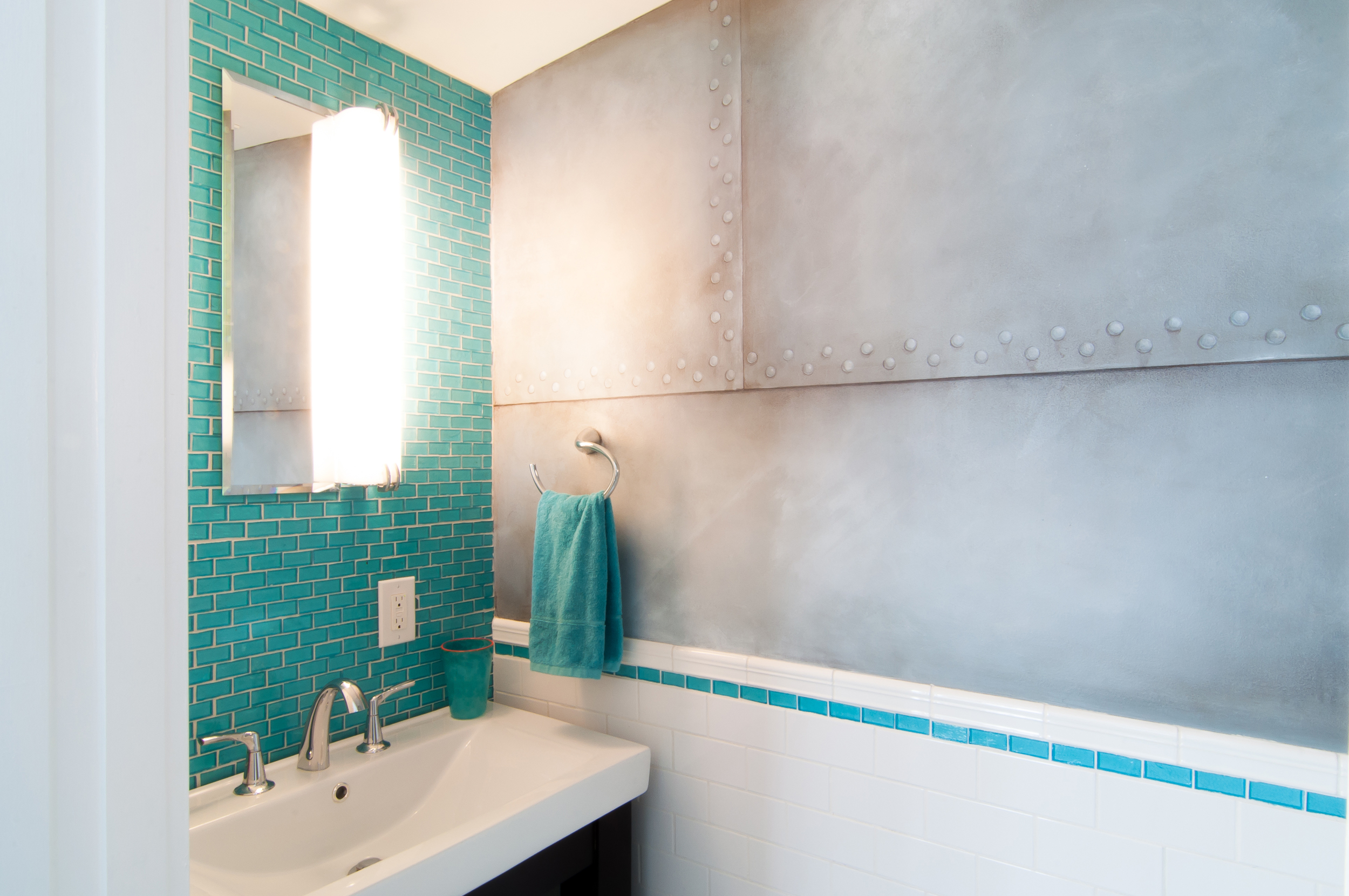 The powder room with metal plate faux finishing by Kerry Cesen.