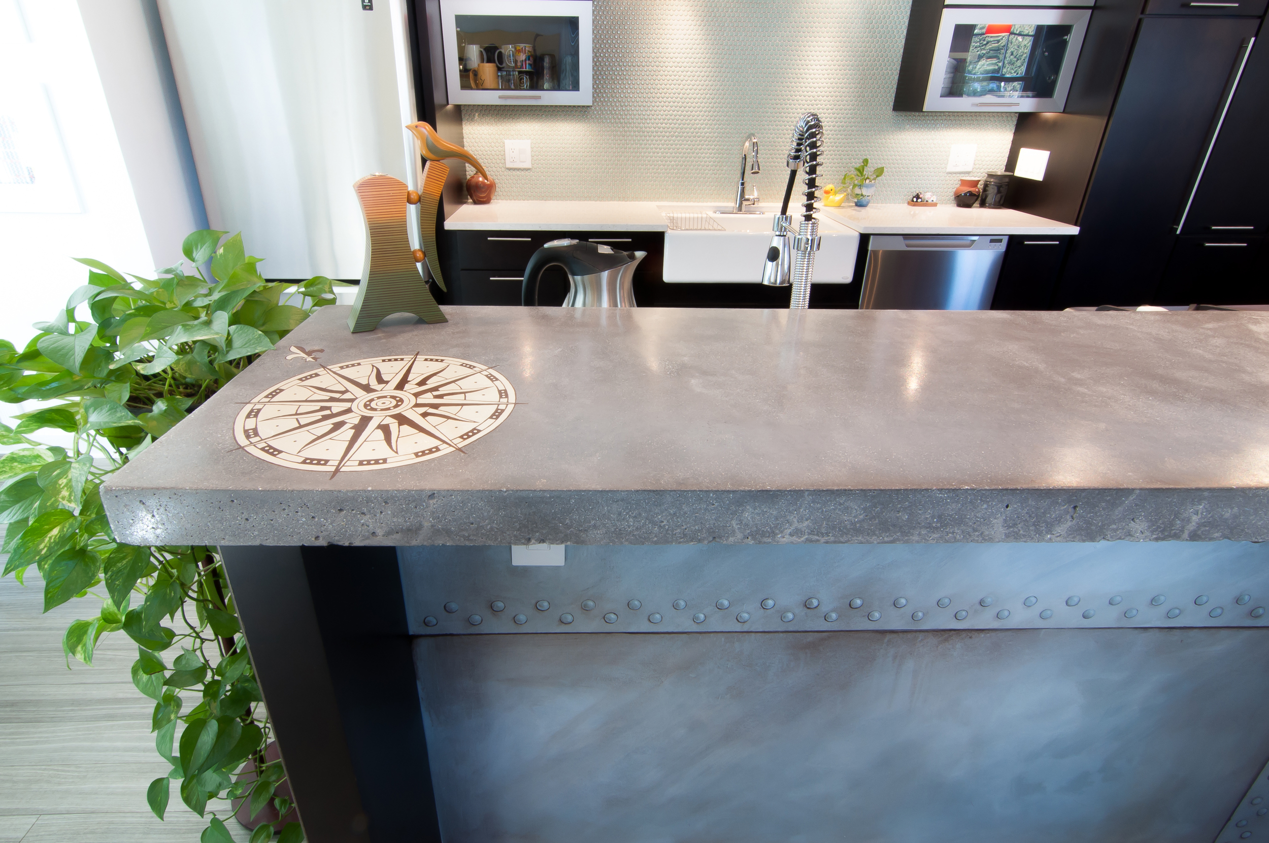 More faux finishing work under the bar counter and on the concrete countertop.