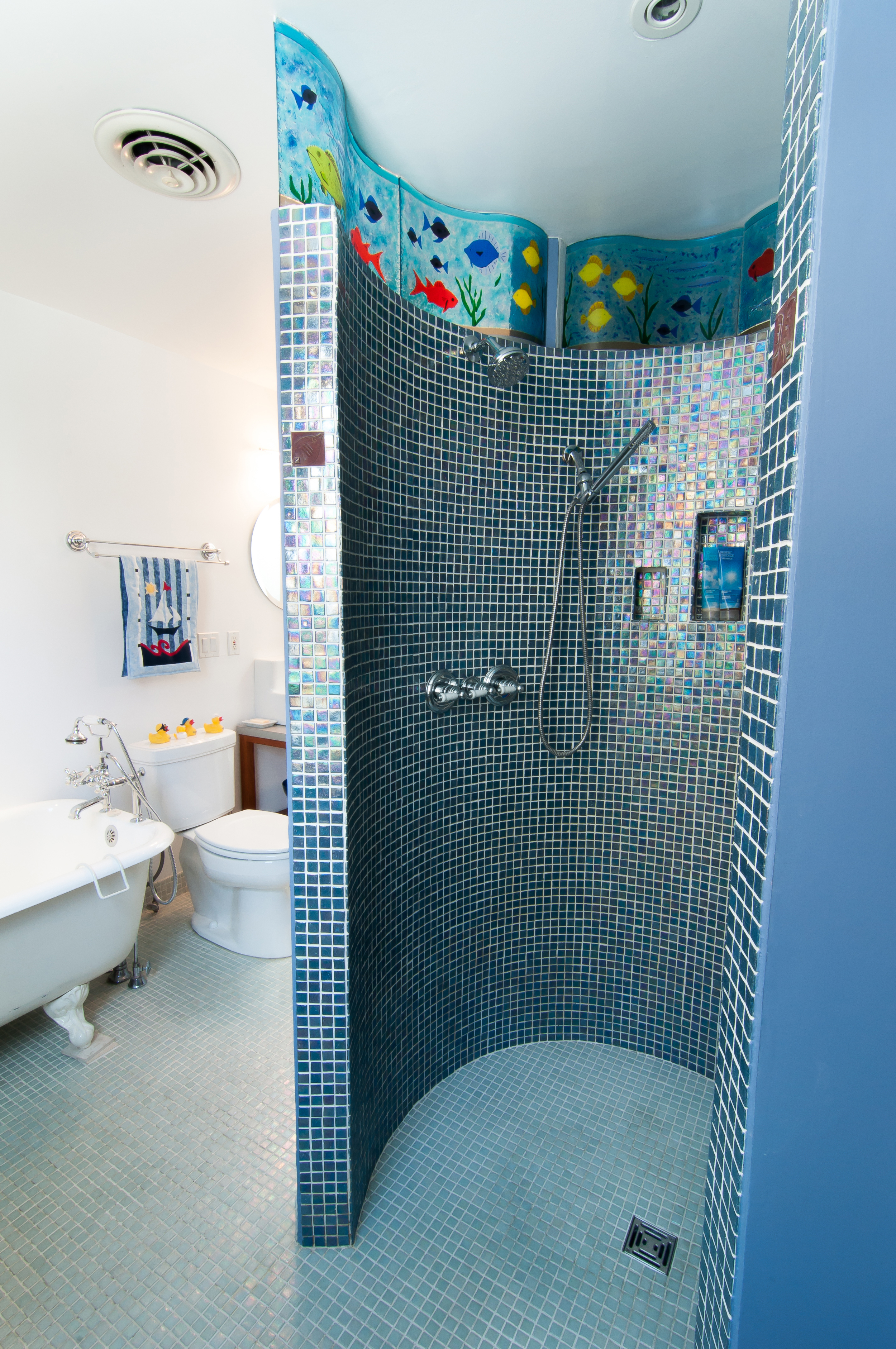 Custom tile work and mosaic glass in the walk out shower.