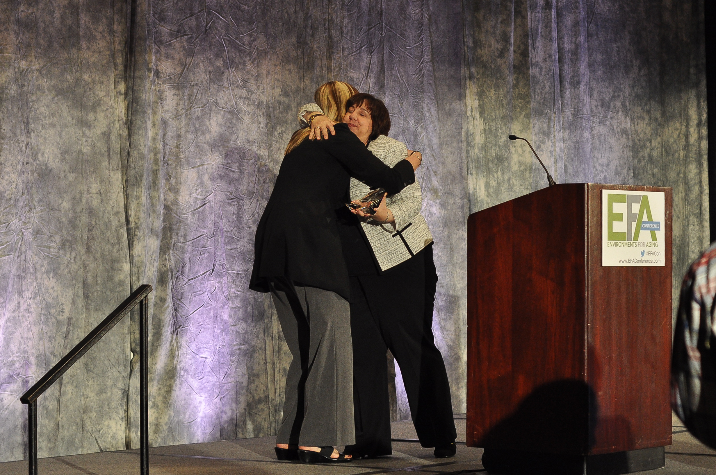 Jane Rohde accepting The Center For Health Design's Changemaker Award at the Environments for Aging Conference from President and CEO of The CHD, Debra Levin