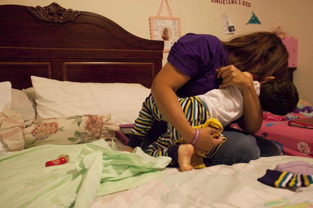 Jacel hugging her son Bruno at home. Miami, FL