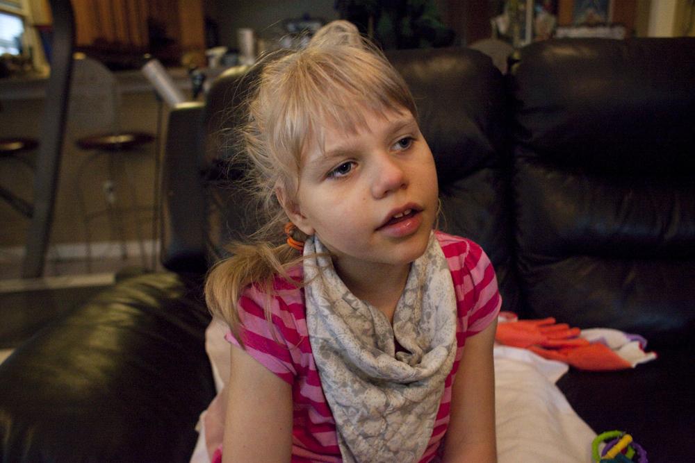 Christina Clark sitting in the family room of her home. Jacksonville, FL