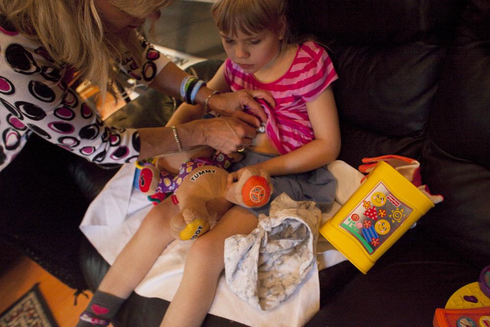Anneliese attaches CHristina's feeding tube. Jacksonville, FL.