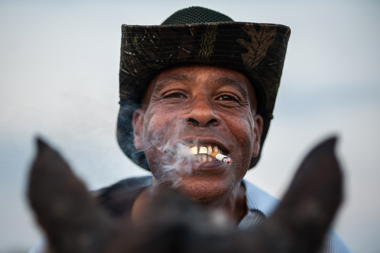 A cowboy named James poses for a portrait in Bolivar County, Mississippi.