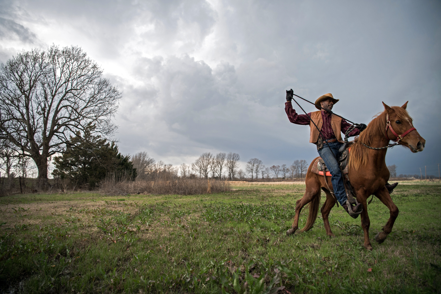 Moonie breaks a horse for the first time just before a looming storm near Cleveland, Mississippi.