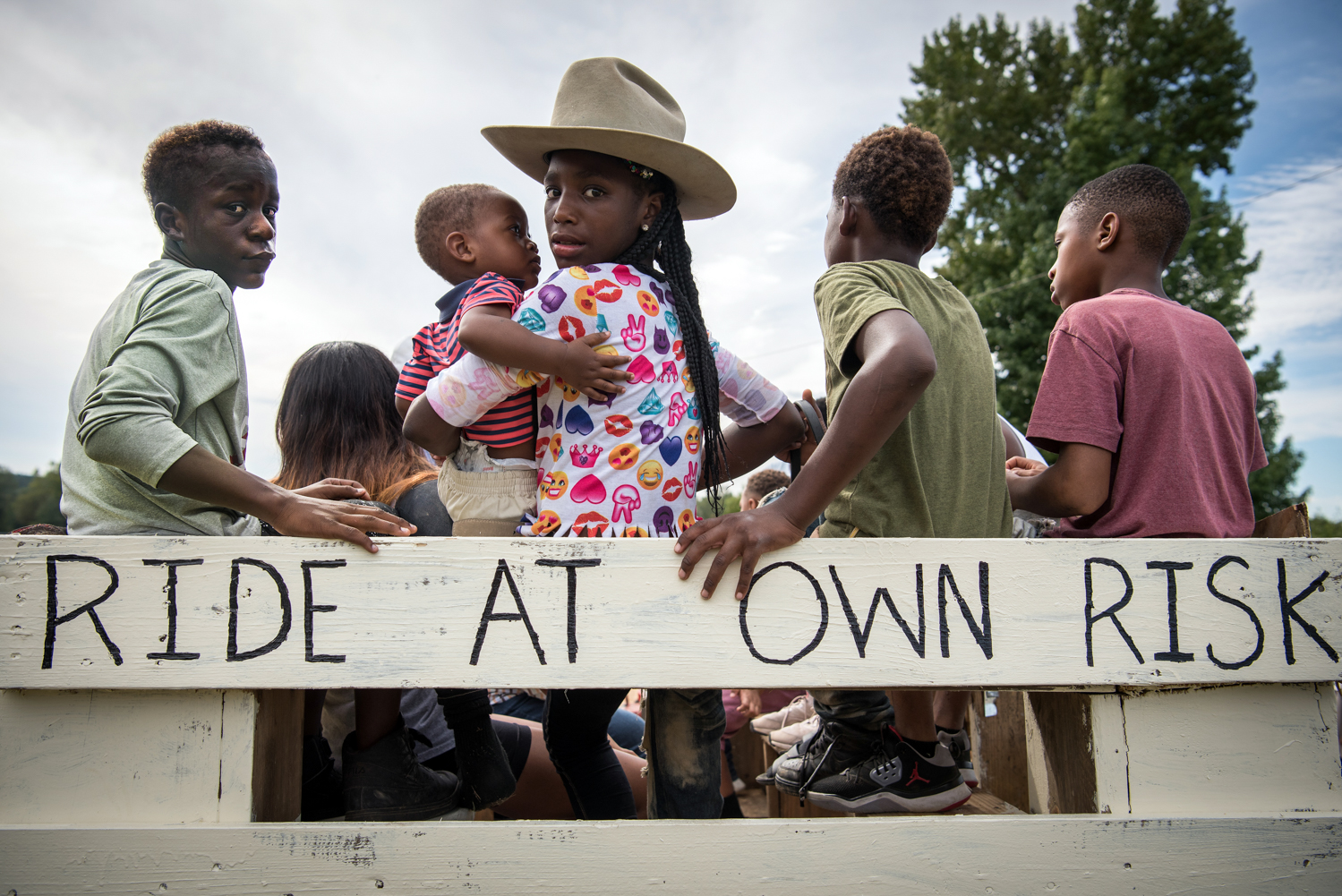 A group of kids wait for a trail ride to begin in rural Tallahatchie County, Mississippi.