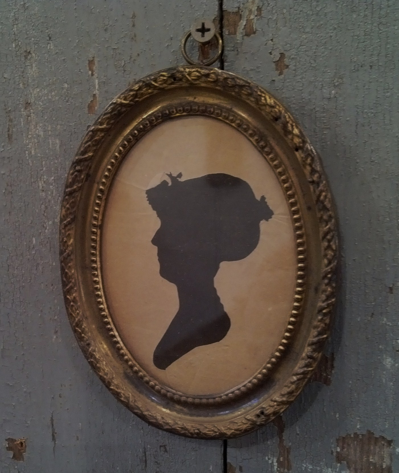 Silhouette in oval frame