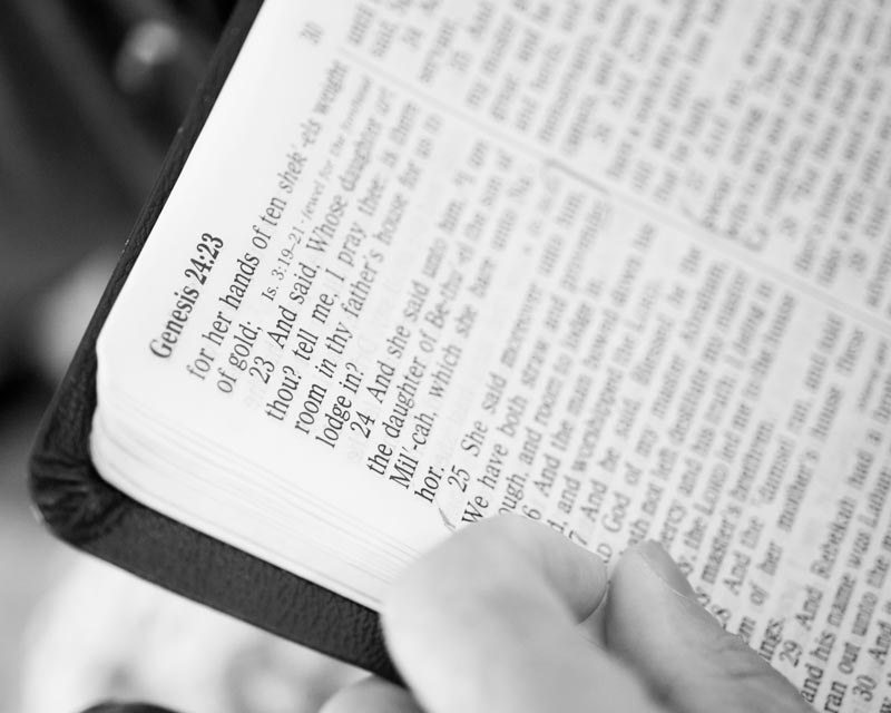 He reads the Bible aloud to his wife because she can't comprehend written language anymore.