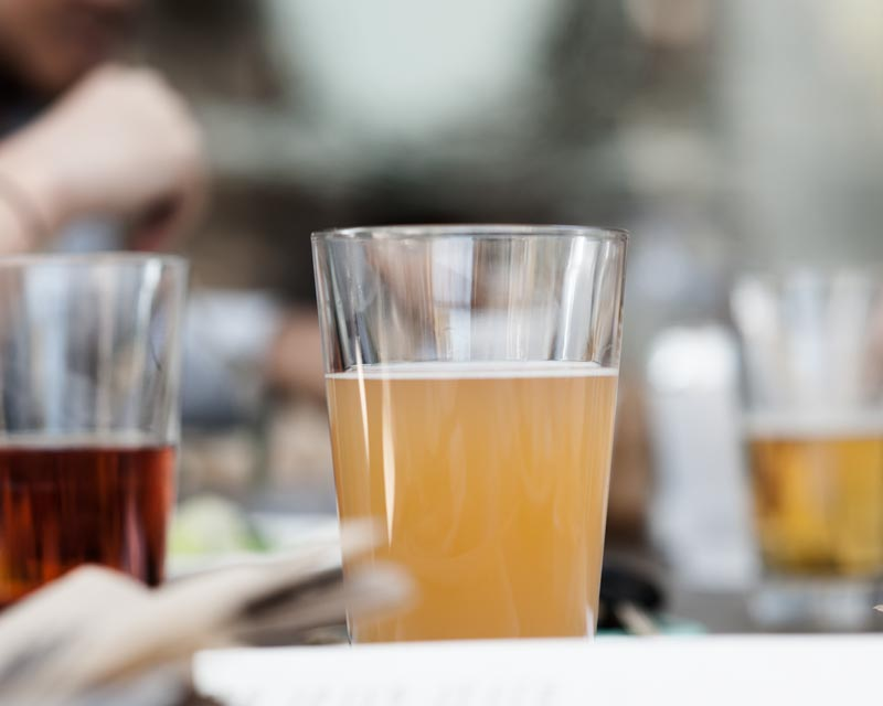 Urban Hive members share drinks at Low Brau during a community lunch.