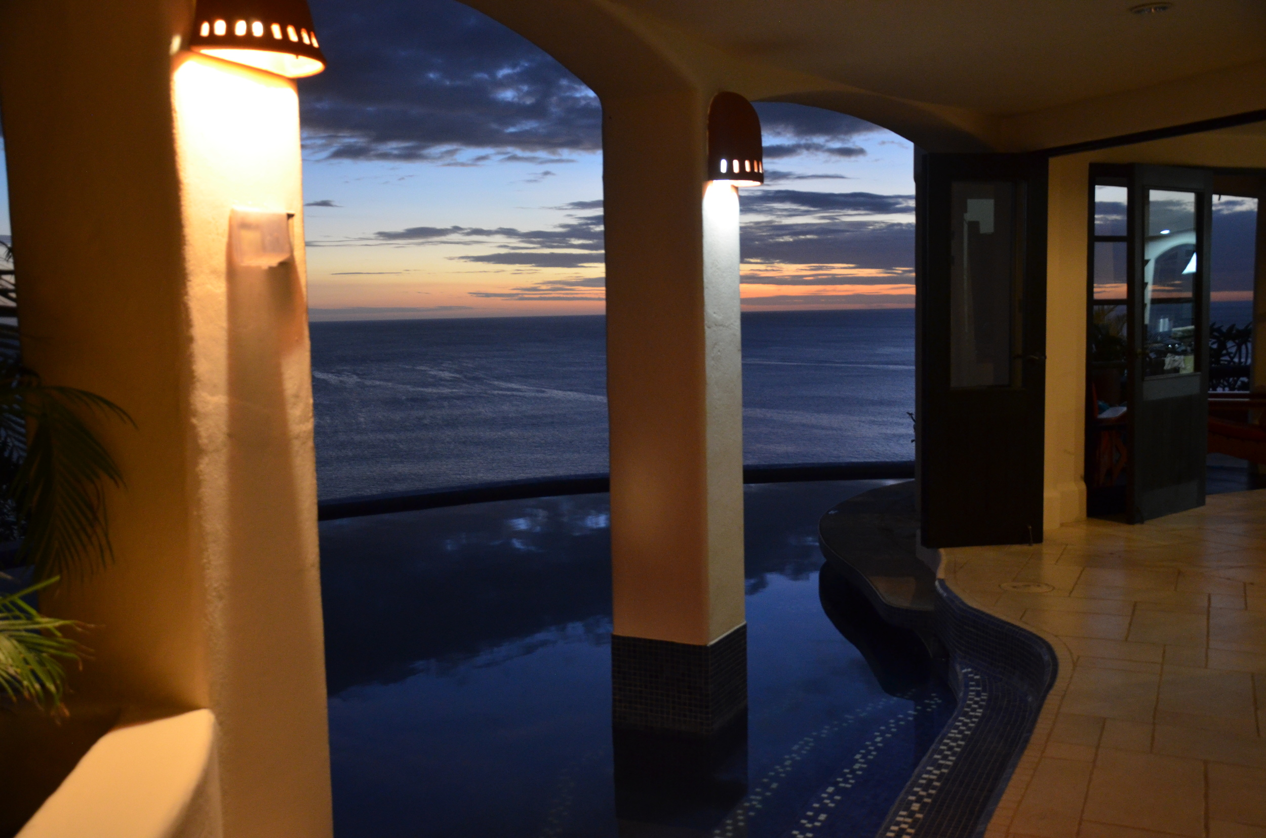 Sunset under the covered poolside terrace