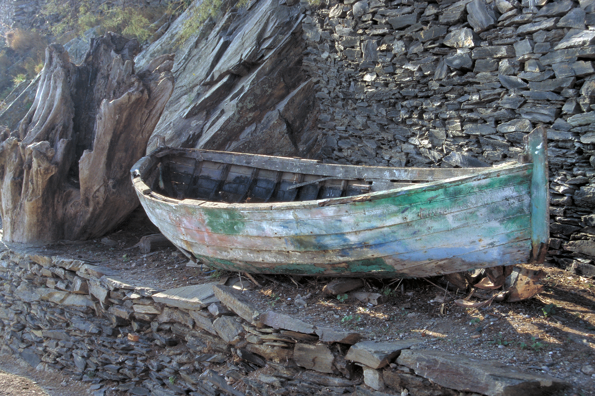 Once Upon the Sea            Spain  Old boat perched below Salvadore Dalis house   Purchase
