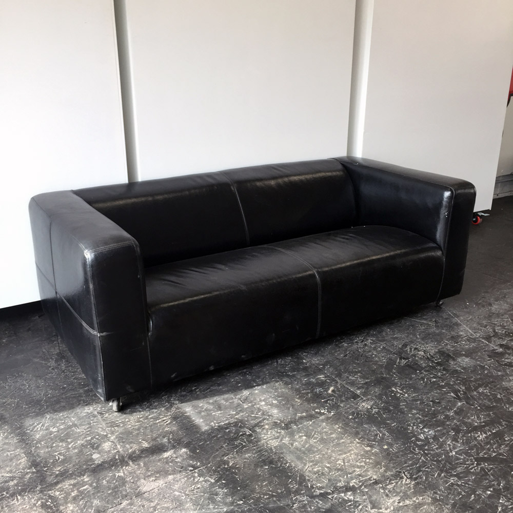 $100 - Leather Ikea Couch - The legs were removed and replace with casters.