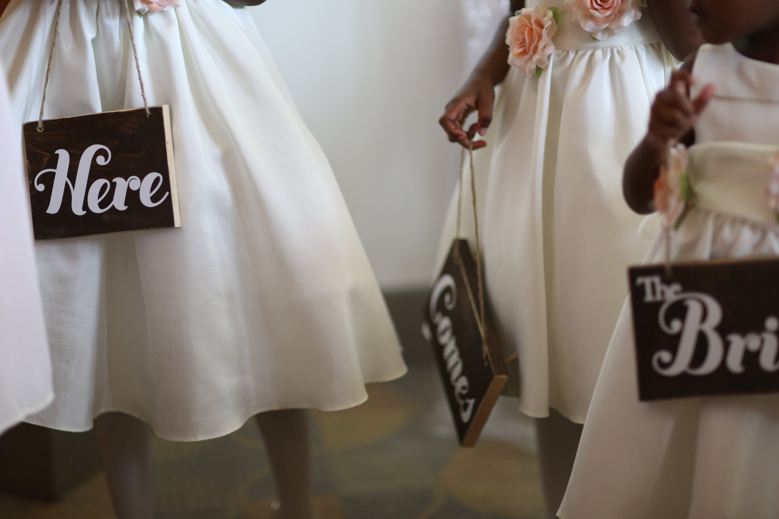 These signs were hand crafted by my brother (Petra Pream) and were so perfect for the three flower girls.