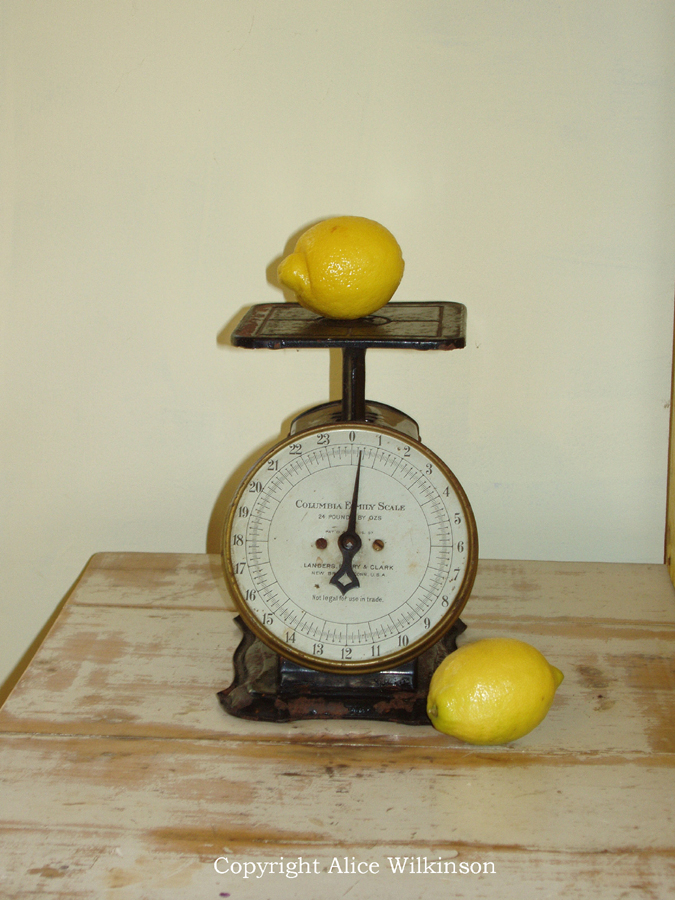 scale and 2 lemons
