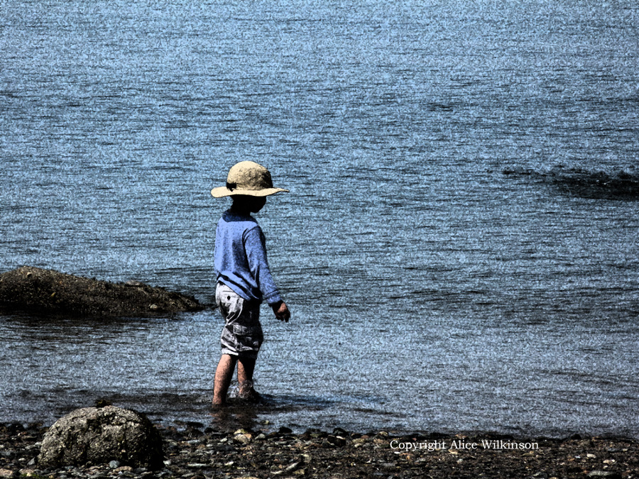 small boy on beach, another view