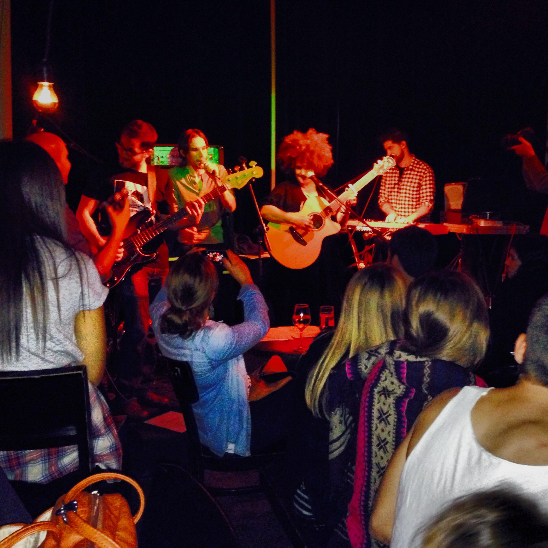Listening to famous Israeli singer/songwriter Karolina sing live at hipster hangout Rothschild 12 in Tel Aviv.