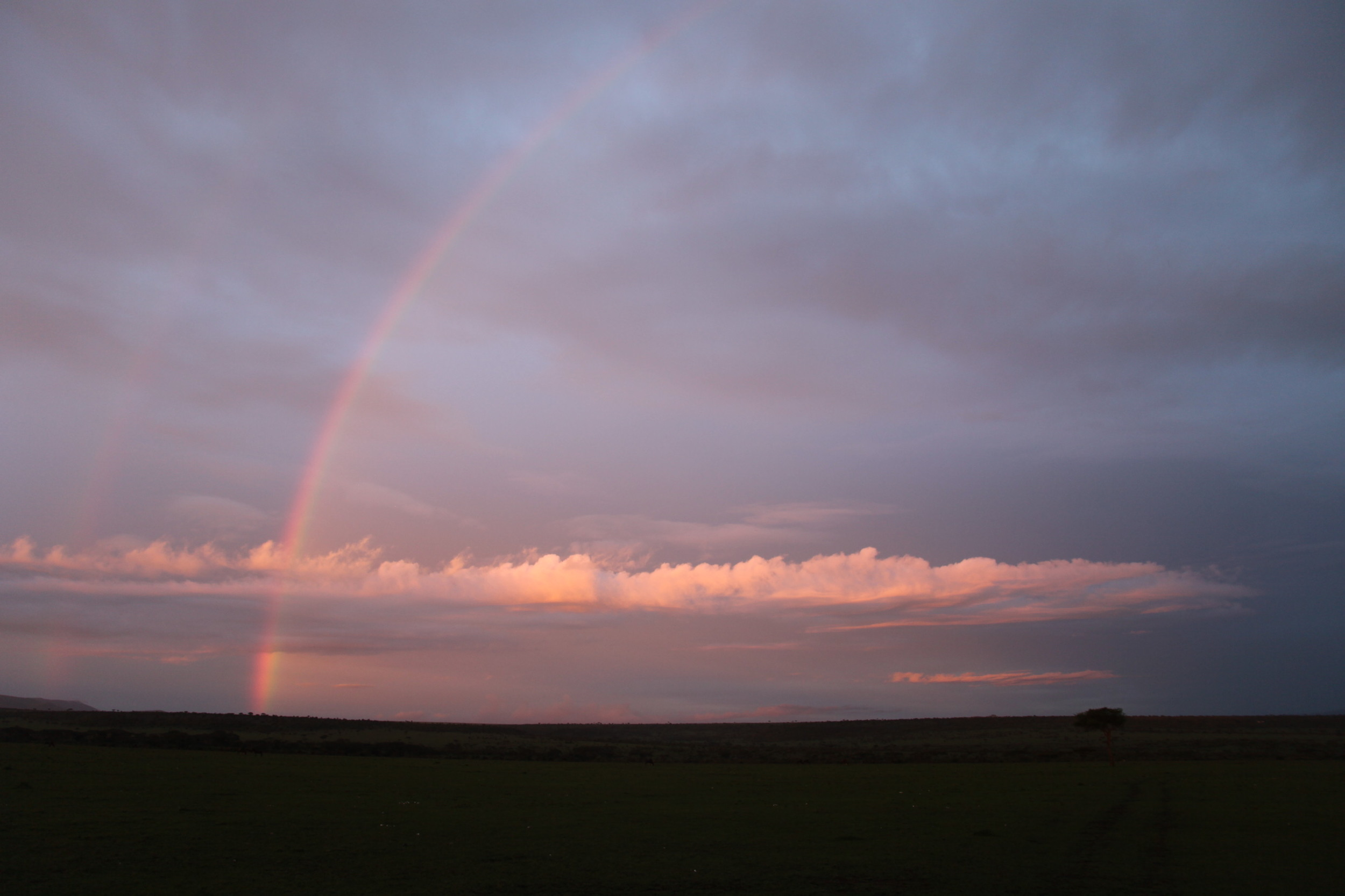 Parallel rainbows after the rainfall.