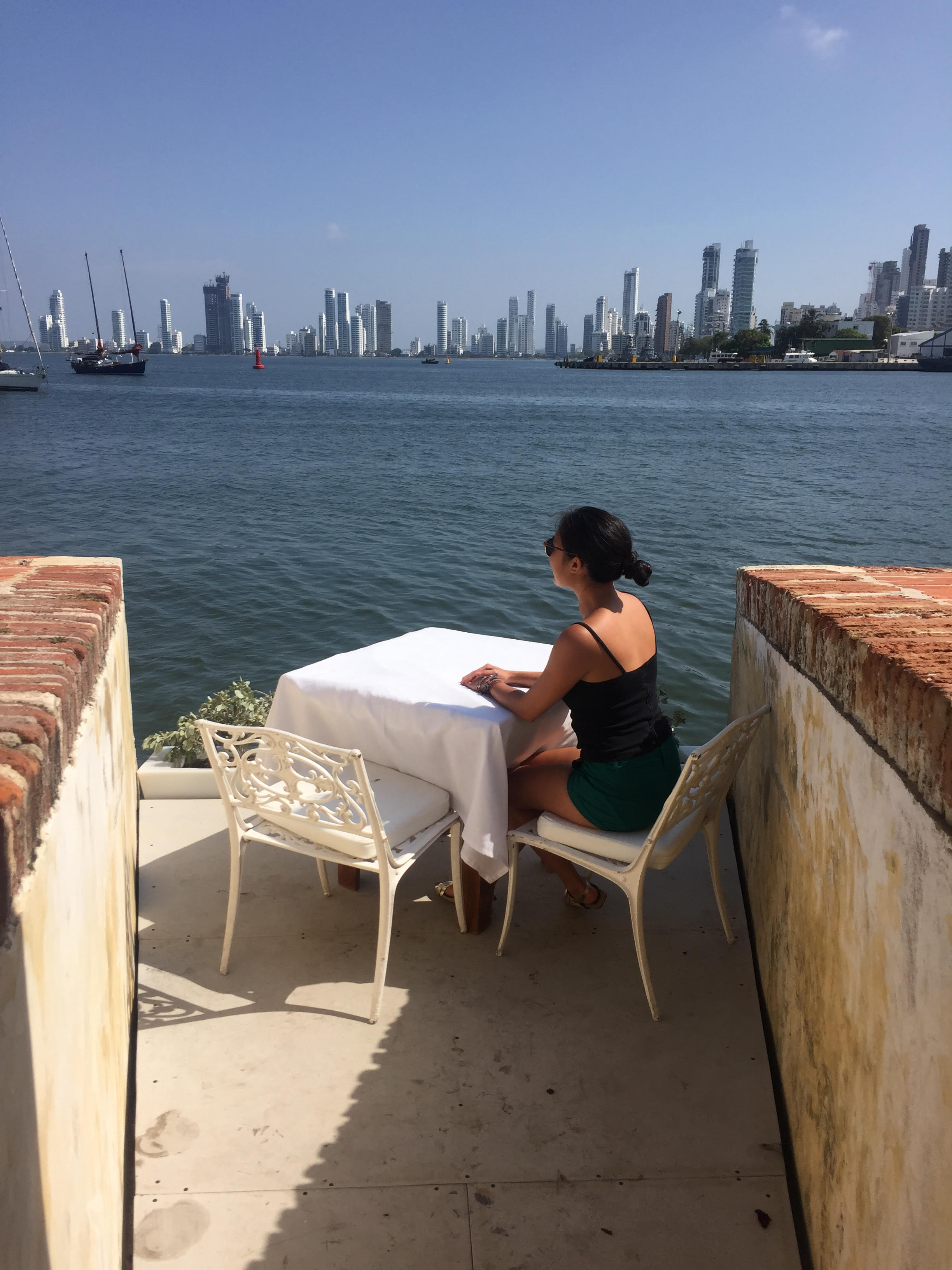 A secluded table with a view at Club de Pesca.