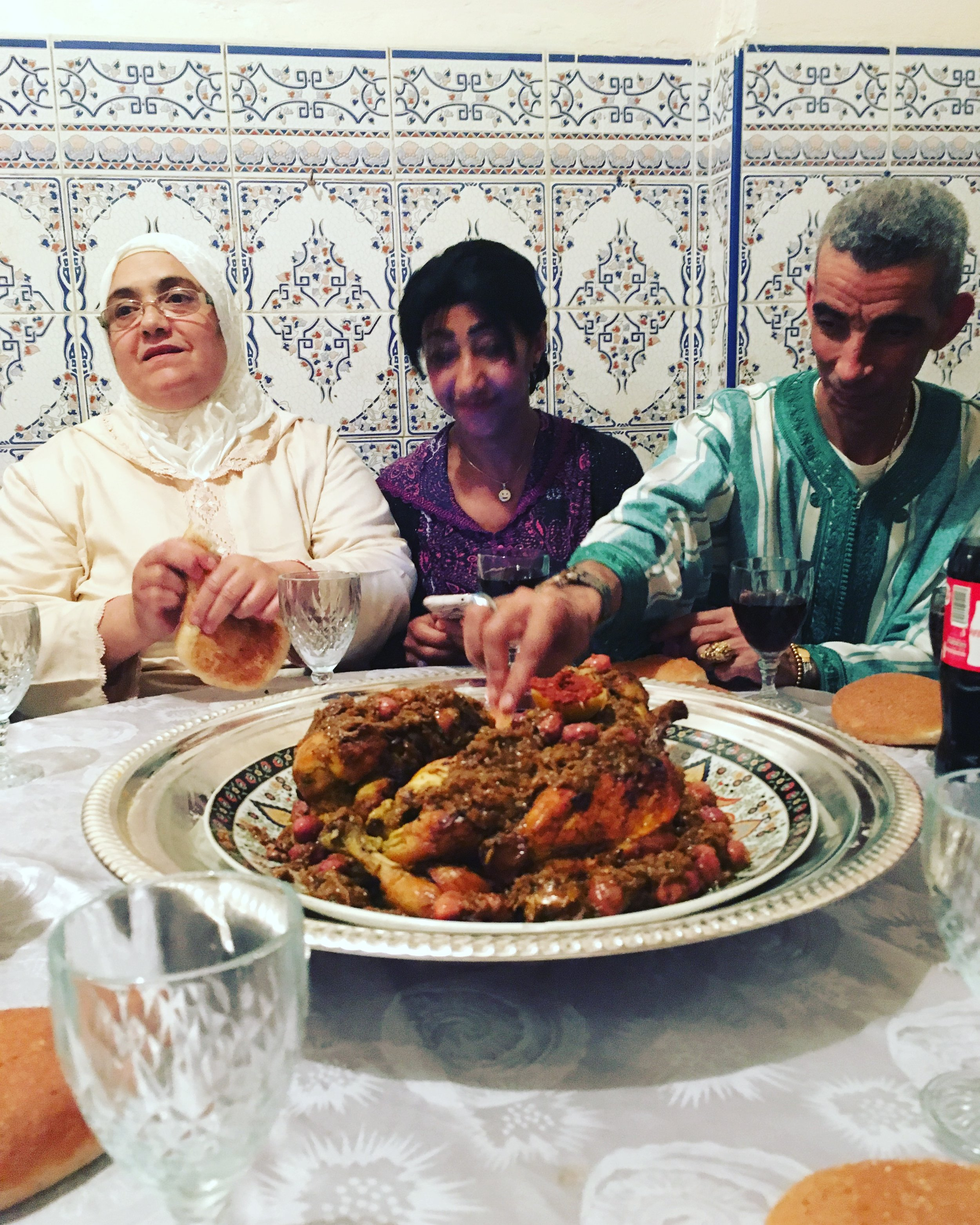 "Lots of food at the Lila – communal eating around the bowl with your hands. ""Djaj Mhammar"" is a very delicious Moroccan chicken dish."