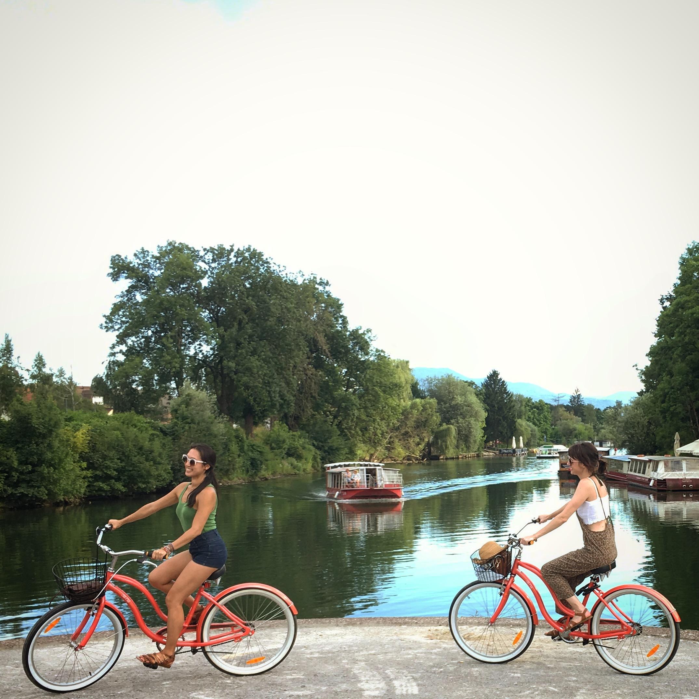 Biking by the Ljubljanica River.