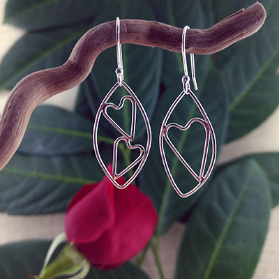 Sterling silver leaf with single and double heart earrings - $70.