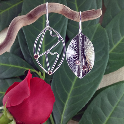 Sterling silver foldform and wire with double hearts earrings - $84.