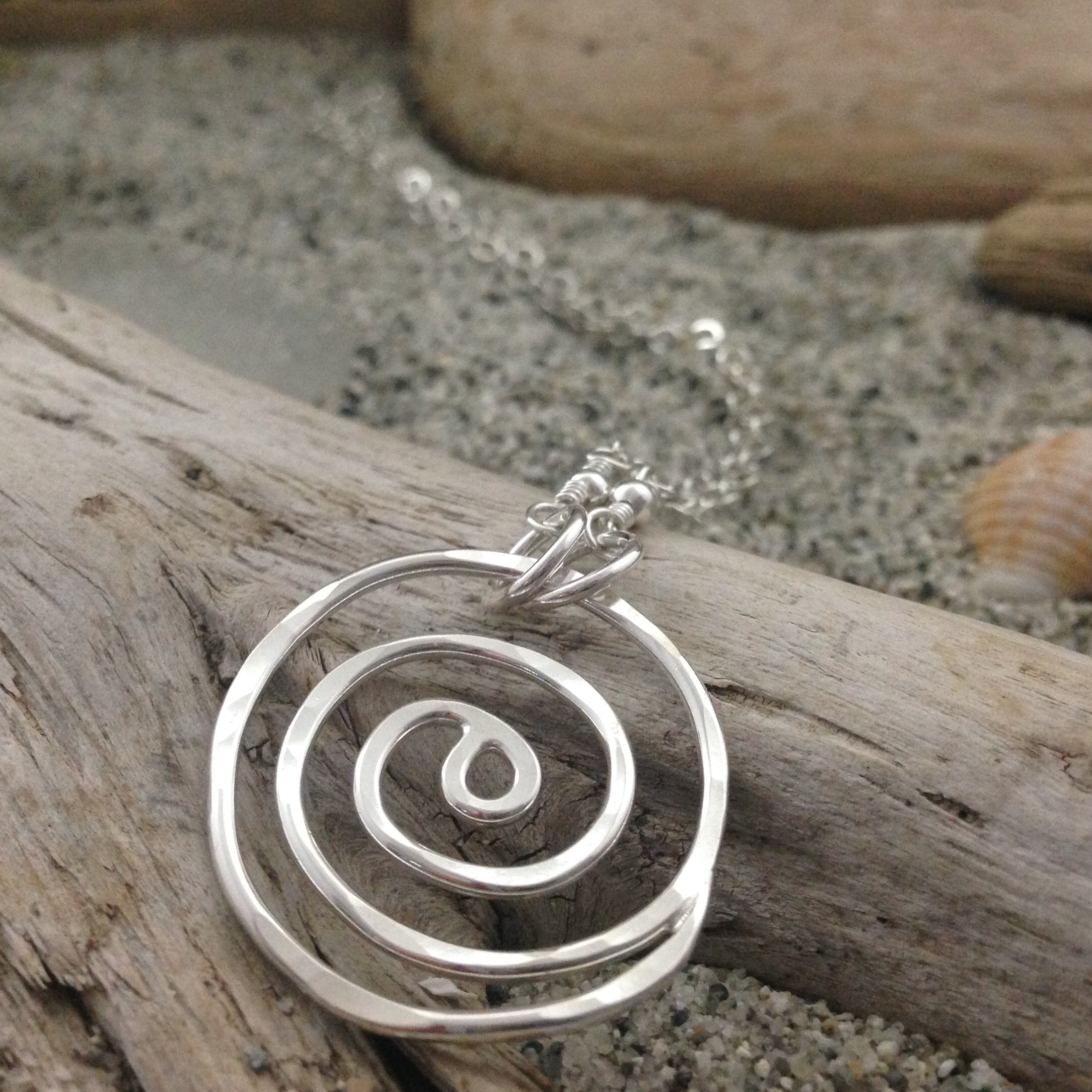 "Sterling silver 'heart of the wave' pendant with sterling silver chain; 26.5"" - $156."