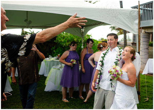wedding guest tossing rice at newly married couple