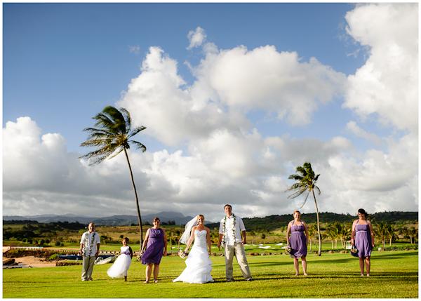 classic wedding party portrait on kauai beautiful clouds palm trees