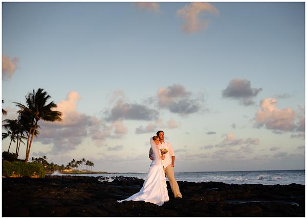 wedding portraits on rocky shore of poipu in hawaii