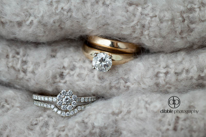 two sets of wedding and engagement rings
