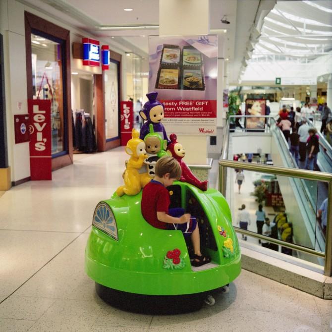 "Haruhiko Sameshima - Scene, ""Westfield St Lukes Shopping Centre"" (child in a Teletubbies ride), 2003"