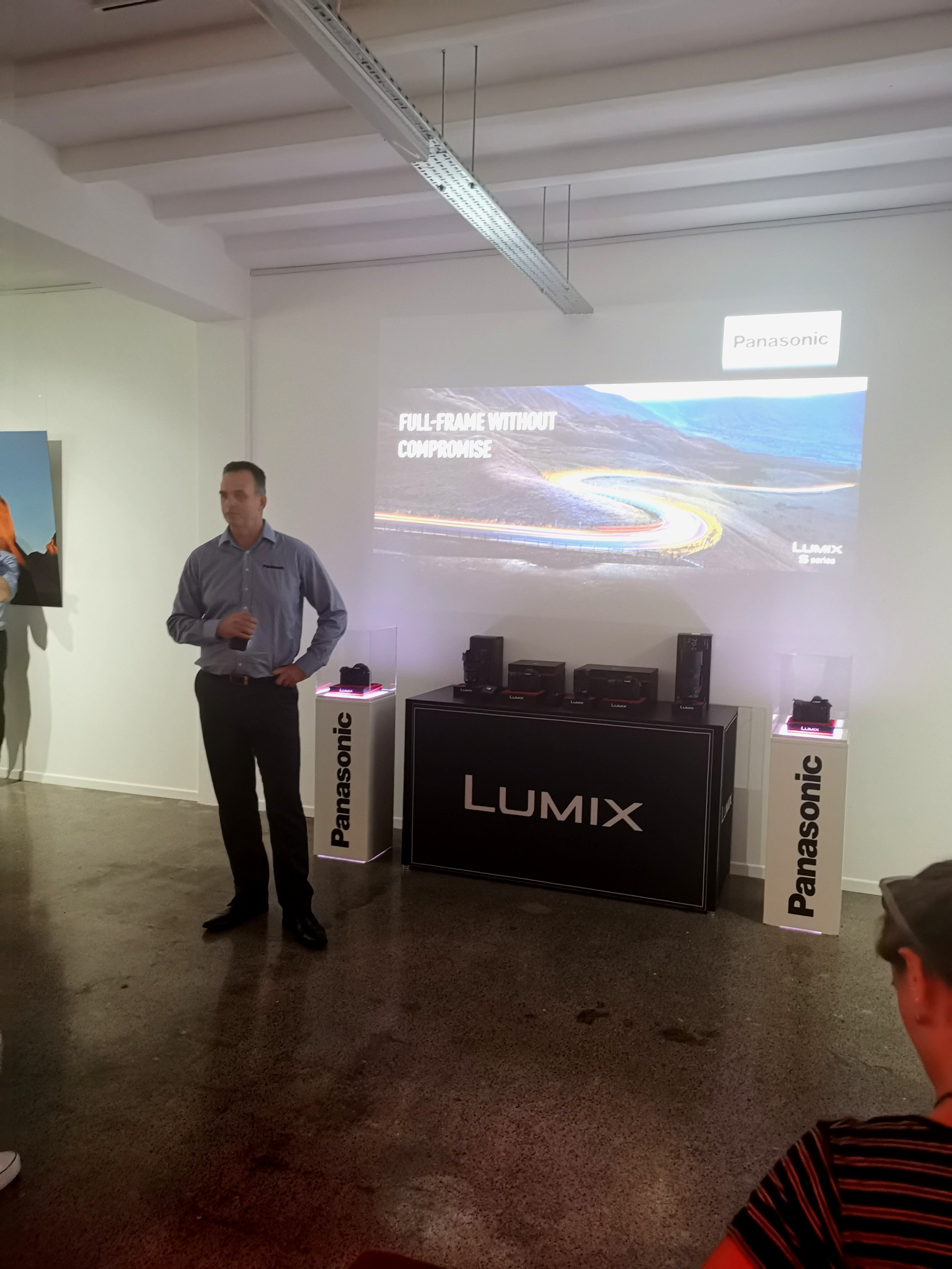 Panasonic Product Manager Andrew Reid presenting the specs of the two new mirrorless models to industry professionals