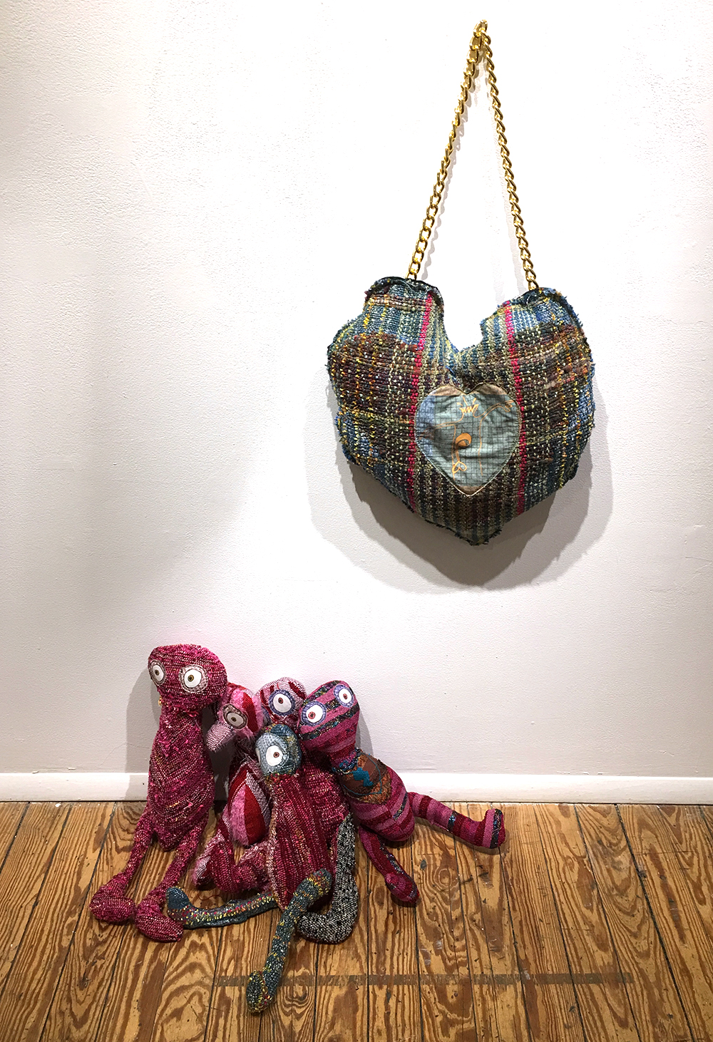"Just Send Flowers (left)  h: 17"" x w: 20"" x d: 8"" hand-woven and machine-made fabric, embroidery, inkjet prints, fleece 2017   Blow My Brains Out  h: 17"" x w: 13"" hand-woven and machine-made fabric, embroidery, inkjet prints, fleece, chain 2017"
