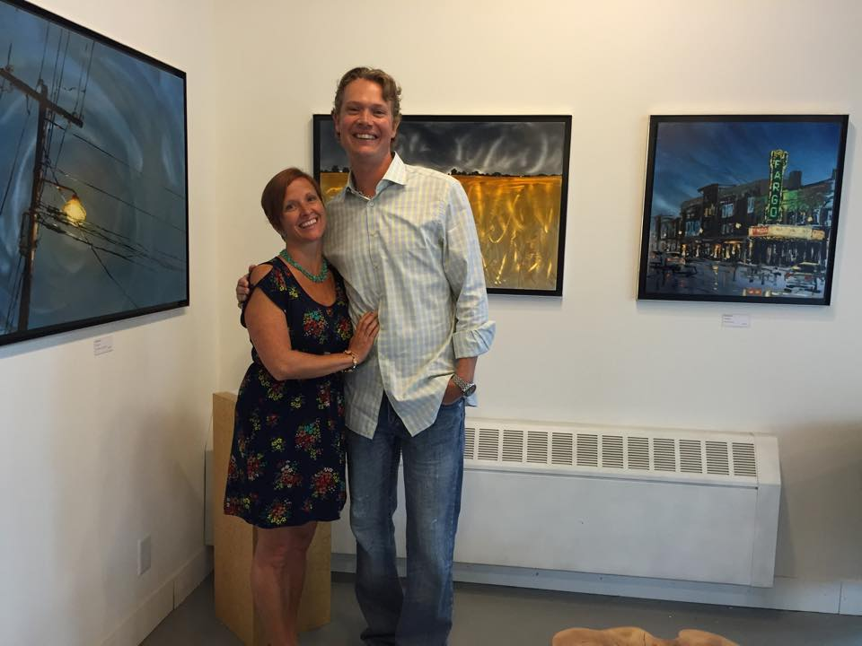 Us cheesing it at one of said art shows... her smile... love it.