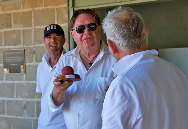 Bryan Dawe presents Maygars Ball to Captain Scotty McKay as Captain Greg   Palmer looks on