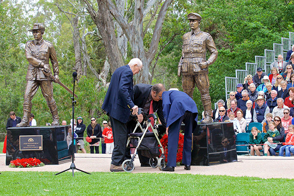 The Tubbfamily laying their wreath as Col. Leslie Maygar looks on.