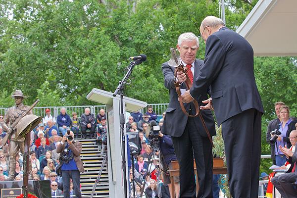 Ian Kerr (Maygar)presents RSL Sub Branch President, Phil Munt with Col. Leslie Maygar's ceremonial sword.