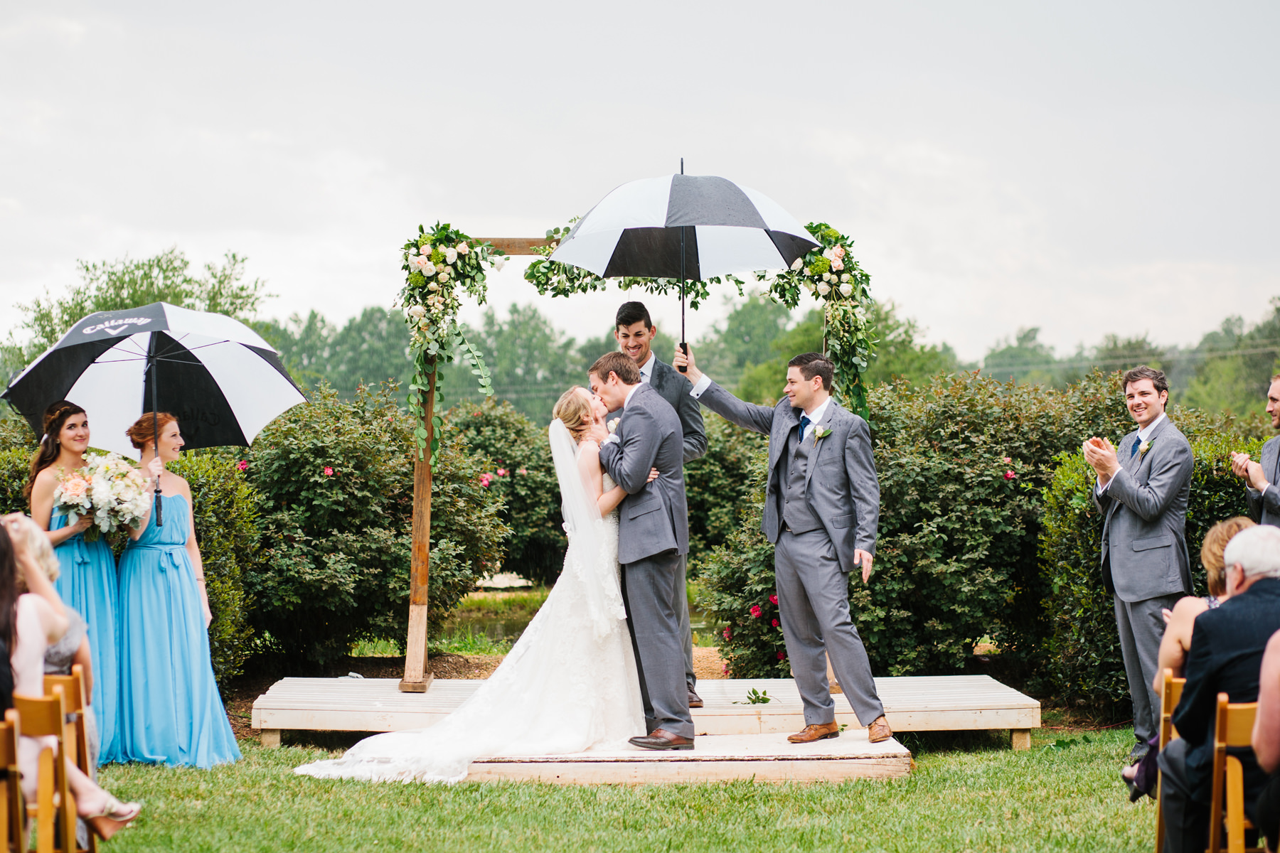 Bride and Groom First Kiss in the Rain