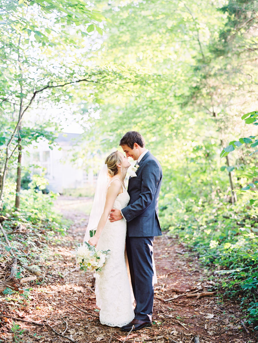 Bride and Groom in the Woods Laughing