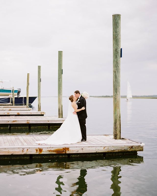 A little romance out on the docks. ⛵💙⚓ Photo from Celia & Pete's beautiful spring wedding at @CarolinaYachtClub_NC. . . . . . . . . #incontrastimages #yachtclubwedding #nauticalwedding #nauticalweddings #carolinayachtclub #carolinayachtclubwedding #wrightsvillebeachwedding #wrightsvillebeachweddings #wilmingtonweddings #wilmingtonphotographer #wilmingtonncphotographer #wilmingtonweddingphotographer #wilmingtonweddingphotography #northcarolinaweddingphotographer #ncweddingphotographer #ncweddingphotographers #ncweddingphotography #ncwedding #ncweddings #northcarolinawedding #raleighweddingphotographer #raleighfilmphotographer #contax645 #film #portra400 #kodakportra400 #indiefilmlab #filmweddingphotography #filmweddingphotographer #hybridweddingphotographer