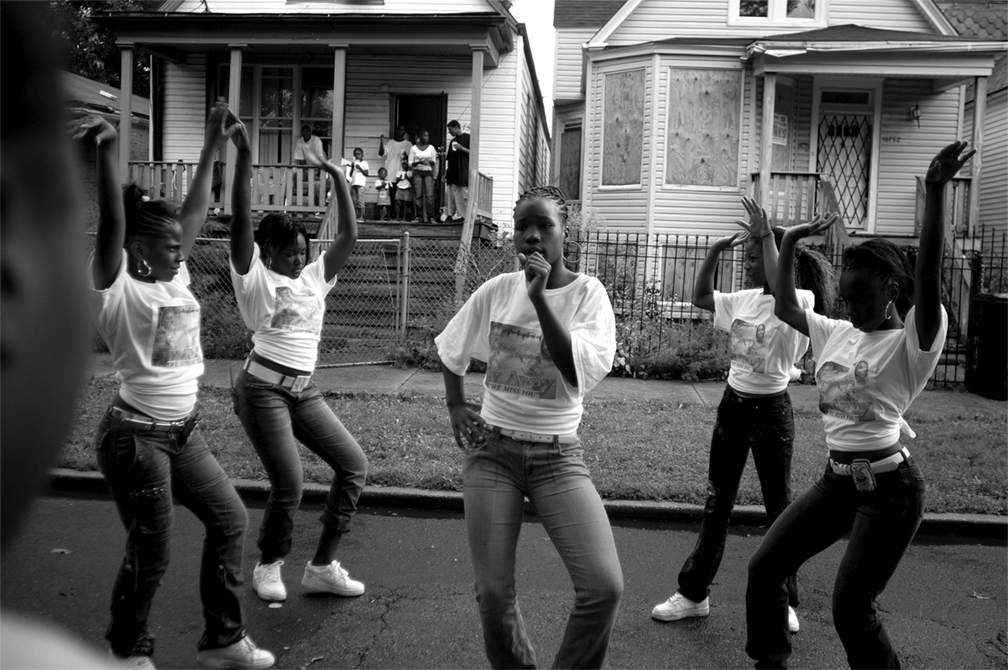 © Carlos Javier Ortiz from  We All We Got   Girls in the Englewood neighborhood on Chicago's South Side attend a block party to celebrate the lives of Starkeisha Reed, 14, and Siretha White, 12. Englewood, Chicago, 2008.
